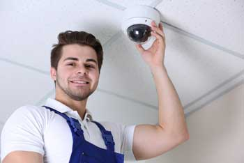technician installing security camera system in Houston